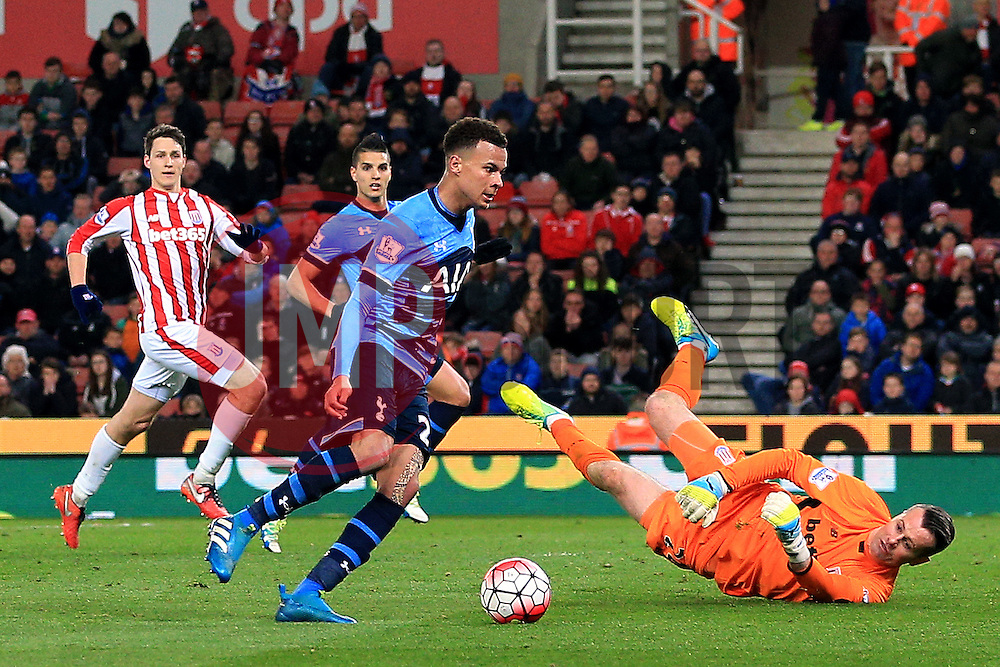 Dele Alli of Tottenham Hotspur takes the ball around Shay Given of Stoke City but hits the post - Mandatory by-line: Matt McNulty/JMP - 18/04/2016 - FOOTBALL - Britannia Stadium - Stoke, England - Stoke City v Tottenham Hotspur - Barclays Premier League