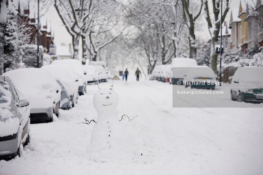 A boy sledges downhill after unusually large amounts of snow fall in South London.