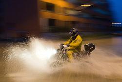 ATV (Quad bike) driving through the crossroad full water after heavy rain on September 18, 2010, in Ljubljana, Slovenia. (Photo by Matic Klansek Velej / Sportida)