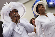 Worshippers wipe away tears during Rev. Al Sharpton address to a healing service at Charity Missionary Baptist Church April 12, 2015 in North Charleston, South Carolina. Sharpton spoke following the recent fatal shooting of unarmed motorist Walter Scott police and thanked the Mayor and Police Chief for doing the right thing in charging the officer with murder.