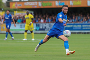 AFC Wimbledon defender Luke O'Neill (2) lining a shot up oin goal during the EFL Sky Bet League 1 match between AFC Wimbledon and Wycombe Wanderers at the Cherry Red Records Stadium, Kingston, England on 31 August 2019.