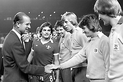 File photo dated 27-10-1975 of Chelsea captain Ray Wilkins (centre) introduces the Duke of Edinburgh to members of his team at Stamford Bridge before the charity match between Chelsea and the Italian Under-23s in aid of the National Playing Fields Association.
