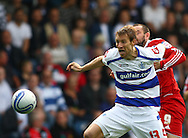 Loftus Road, London - Saturday 11th September 2010: Kaspars Gorkss (13) of QPR is challenged by Kris Boyd (9) of Middlesborough during the Npower Championship match between Queens Park Rangers and Middlesborough. (Photo by Andrew Tobin/Focus Images)