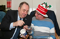 First Minister Alex Salmond, accompanied by Santa Clause, visited the Dean Club in Stiockbridge Edinburgh today to distribute Christmas presents to the residents. Hugh Copland shared his chocolates with the First Minister (c) GER HARLEY | StockPix.eu