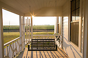 The sun rises behind a swing on the front porch of the boyhood home of musician Johnny Cash on Saturday, August 16, 2014, in Dyess, Ark. The home was restored to it's appearance when the Cash family lived in it, from 1935-1954, and was part of The Dyess Colony that was created in 1934 as part of President Franklin D. Roosevelt's New Deal.<br /> <br /> Photo by Beth Hall
