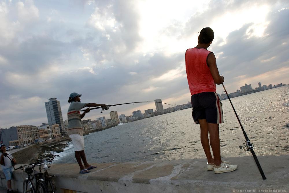 Fishermen on the Malekon (sea-side) of Havana - CUBA