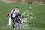 Tiger Woods hits out of the bunker trap<br /> WM Phoenix Open 2015, TPC Scottsdale, Arizona, USA<br /> January 2015<br /> Picture Credit:  Mark Newcombe / www.visionsingolf.com