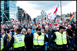 Hundreds of EDL supporters attend the protest against what they see as the influence of Islam in the Tower Hamlets area of London, United Kingdom. Saturday, 7th September 2013. Picture by Piero Cruciatti / i-Images
