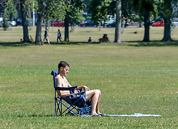 Pictured: Sun seekers bask on Leith Links as the Capital sweltered in 27 degree heat.<br /> <br /> &copy; Dave Johnston / EEm