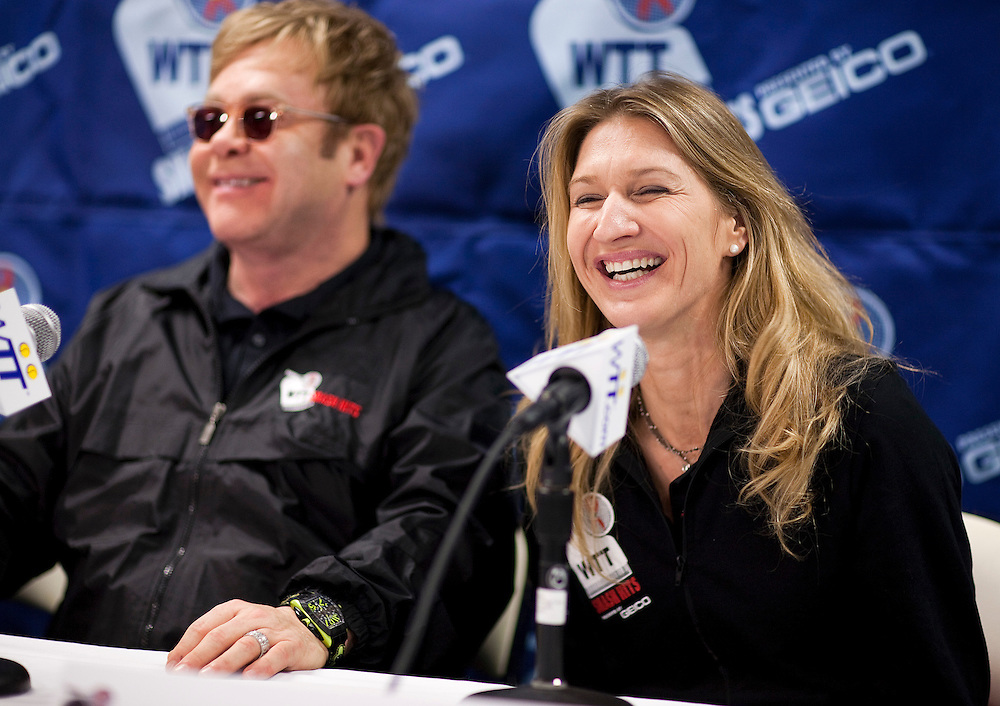 Stefanie Graf and Sir Elton John speak at a press conference for the World Team Tennis Smash Hits fundraiser in Washington on November 15, 2010. The event is raising money for HIV/AIDS. REUTERS/Joshua Roberts    (UNITED STATES)