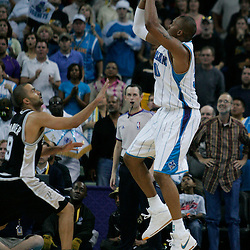 29 March 2009: New Orleans Hornets forward David West (30) shoots over San Antonio Spurs guard Tony Parker (9) during a 90-86 victory by the New Orleans Hornets over Southwestern Division rivals the San Antonio Spurs at the New Orleans Arena in New Orleans, Louisiana.