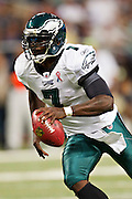 ST. LOUIS, MO - SEPTEMBER 11:   Michael Vick #7 of the Philadelphia Eagles runs with the ball against the St. Louis Rams at the Edward Jones Dome on September 11, 2011 in St. Louis, Missouri.  The Eagles defeated the Rams 31 to 13.  (Photo by Wesley Hitt/Getty Images) *** Local Caption *** Michael Vick