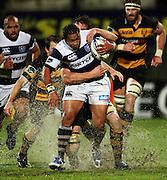 Jason Eaton wraps up Auckland halfback Taniela Moa.<br /> Air New Zealand Cup rugby match - Taranaki v Auckland at Yarrows Stadium, New Plymouth, New Zealand. Friday 9 October 2009. Photo: Dave Lintott/PHOTOSPORT