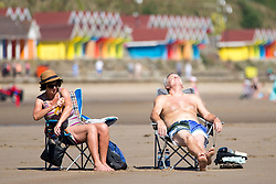 © Licensed to London News Pictures. 19/07/2016. Scarborough Bay UK. Picture shows families enjoying the weather this morning on Scarborough beach. Temperature's are expected to reach a record high today.Photo credit: Andrew McCaren/LNP