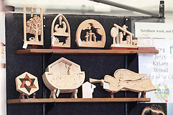 11 July 2015:  Wood scroll work by Jerry Krider of Columbia City Indiana on display at the  2015 Sugar Creek Arts Festival in Uptown Normal Illinois