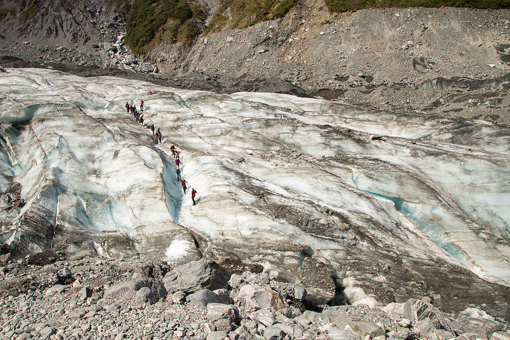 Hikers coming off the Fox Glacier.