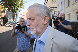 © Licensed to London News Pictures. 24/08/2016. London, UK. Labour party leader Jeremy Corbyn leaves home. Mr Corbyn faces increasing criticism after appearingng in a video sitting on the floor of a crowded train.  Virgin trains owner Sir Richard Branson released cctv footage appearing to show that seats were available. Photo credit: Peter Macdiarmid/LNP