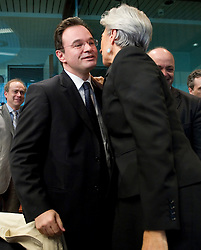 George Papaconstantinou, Greece's finance minister, left, is greeted by Christine Lagarde, France's finance minister, during an emergency meeting of euro zone finance ministers in Brussels, on Sunday, May 2, 2010. Greece accepted an unprecedented bailout from the European Union and International Monetary Fund worth more than 110 billion euros ($146 billion). (Photo © Jock Fistick)