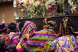 Guatemala, Antigua. Mayan women carrying a float during a Holy Week procession (Easter).