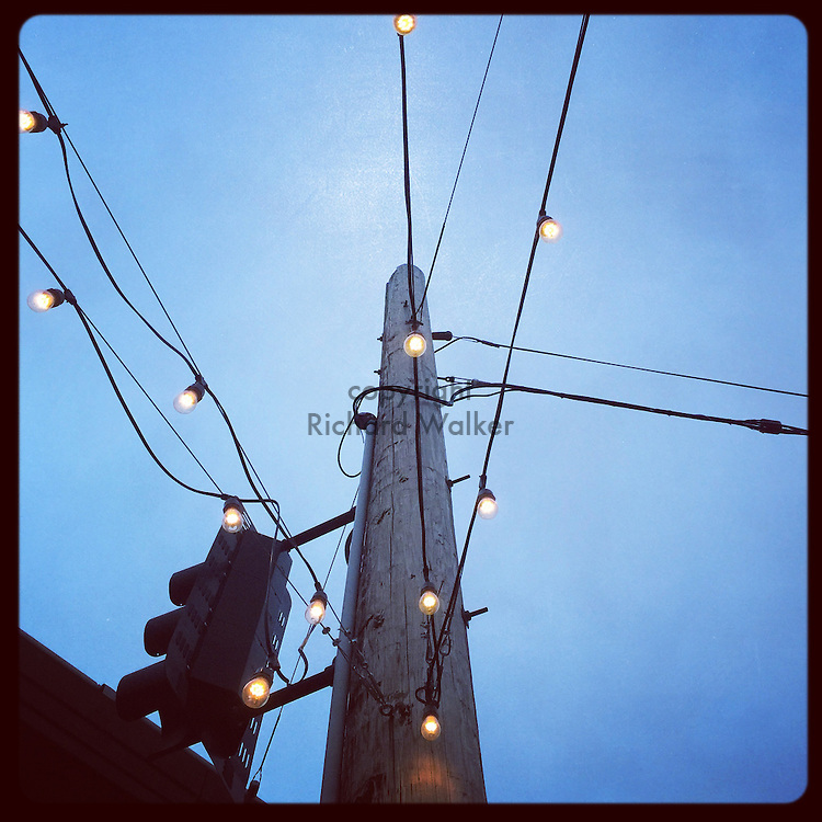 2016 June 02 - Light bulbs on wires outside a business in Georgetown, Seattle, WA, USA. Taken/edited with Instagram App for iPhone. By Richard Walker