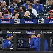 NEW YORK, NEW YORK - May 19: Pitcher Matt Harvey #33 of the New York Mets heads past team mates through the dugout to the dressing room after being pulled from the game in the third inning during the Washington Nationals Vs New York Mets regular season MLB game at Citi Field on May 19 2016 in New York City. (Photo by Tim Clayton/Corbis via Getty Images)