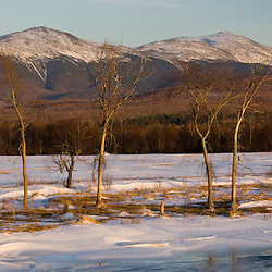 The Presidential Range as seen from Jefferson, New Hampshire.  The Israel River in the foreground is just starting to melt.  Early spring.  White Mountains.