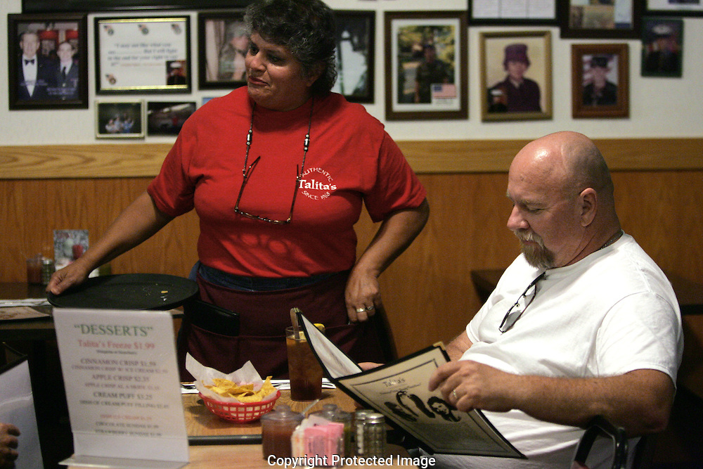 Server Diana Marie Winkler, sister of the owner Frankie Prince, takes care of customers at Talita's Mexican Kitchen, 3090 Southwest Blvd., Grove City, Ohio.(Jodi Miller/Alive)