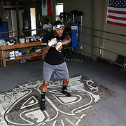"""WINTER HAVEN, FL - MAY 05: Boxer Willie Monroe Jr. works out at the Winter Haven Boxing Gym on May 5, 2015 in Winter Haven, Florida. Monroe will challenge middleweight world champion Gennady """"GGG"""" Golovkin for the WBA world championship title in Los Angeles on May 16.  (Photo by Alex Menendez/Getty Images) *** Local Caption *** Willie Monroe Jr."""
