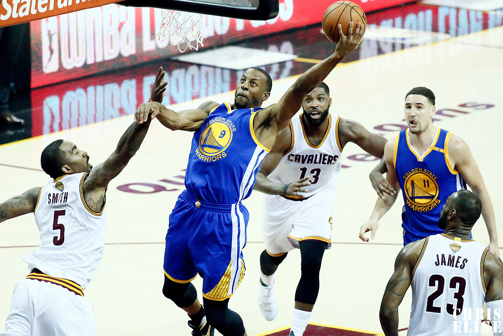 09 June 2017: Golden State Warriors forward Andre Iguodala (9) goes for the layup against Cleveland Cavaliers guard JR Smith (5) during the Cleveland Cavaliers 137-11 victory over the Golden State Warriors, in game 4 of the 2017 NBA Finals, at  the Quicken Loans Arena, Cleveland, Ohio, USA.