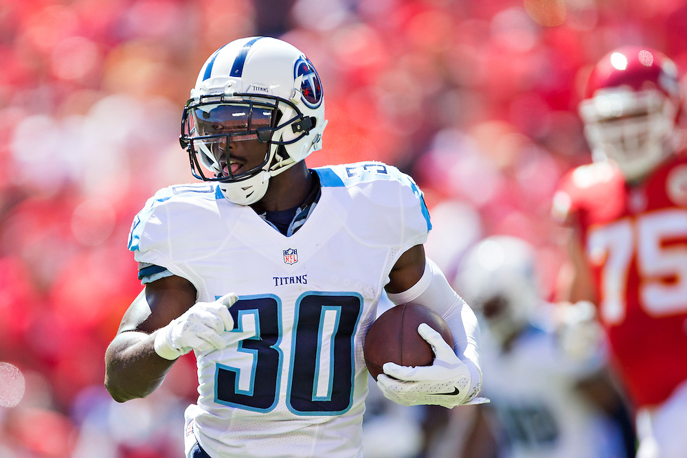 KANSAS CITY, MO - SEPTEMBER 7:  Jason McCourty #30 of the Tennessee Titans runs the ball during a game against the Kansas City Chiefs at Arrowhead Stadium on September 7, 2014 in Kansas City, Missouri.  The Titans defeated the Chiefs 26-10.  (Photo by Wesley Hitt/Getty Images) *** Local Caption *** Jason McCourty