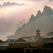 A landscape image of Dimen village in Guizhou province, one of the less developed regions of China because of the moutainous inaccessibility. But all this is changing as speed trains shoot through tunnels built in the last few years.
