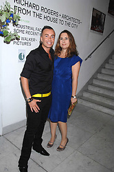 JULIEN MACDONALD and editor of Vogue ALEXANDRA SHULMAN at a reception hosted by Vogue magazine to launch photographer Tim Walker's book 'Pictures' sponsored by Nude, held at The Design Museum, Shad Thames, London SE1 on 8th May 2008.<br />