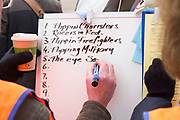 UNITED KINGDOM, Winchester: 05 March 2019 Winchester Pancake Race Photo Feature:<br /> Team names about to compete in the Inaugural Winchester Pancake Race get written on the whiteboard before the start earlier this afternoon on Shrove Tuesday. The race, which consisted of 20 teams, took place in the gardens surrounding Winchester Cathedral. <br /> Rick Findler / Story Picture Agency