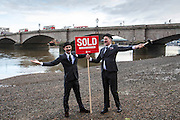 Putney Bridge, SOLD! Sam & John have been travelling around the London borough of Wandsworth selling off Land to greedy land owners. They have been erecting Sold signs at various local landmarks.