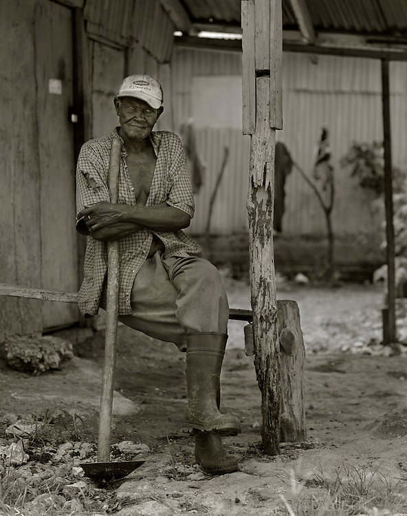 Consuelo, Dominican Republic- An elderly sugarcane worker rests during the workday. Elderly sugarcane workers are especially affected by the harsh working environment of the sugarcane plantations and earn less than younger workers who can cut and produce more cane by ton than the elderly workers.  (Photo by Robert Falcetti)