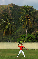 Arias Zuleta warms up before a baseball game between two squads in the Venezuelan Air Force School.  In a continent where soccer reigns supreme, baseball is the national sport in Venezuela.  There are scores of Venezuelans playing in the MBL and many American coahces and players  spend the off season in Venezuela's winter league.