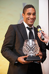 CARDIFF, WALES - Wednesday, November 11, 2009: Wales' Ashley Williams with the Welsh Club Player of the Year trophy during the Football Association of Wales Player of the Year Awards hosted by Brains SA at the Cardiff City Stadium. (Pic by David Rawcliffe/Propaganda)