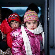 In subfreezing snowy weather, refugees travel the unoffical refugee crossing from the Tabanovce, Macedonia Train Station across the Serbian border.  A daily average of 2,200 refugees have crossed into Serbia throughout the winter.  Warmer months saw highs of 10,000 arrivals. They have escaped their own country in conflict, taken a perilous boat ride from Turkey to Greece, and then moved onward through disorienting foreign lands in search of a peaceful home. Most refugees are headed to welcoming Germany. They are from  Afghanistan, Iraq, and Syria, with a wide range of socioeconomic backgrounds. January 2016.