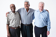 Multiracial group of older men smiling,