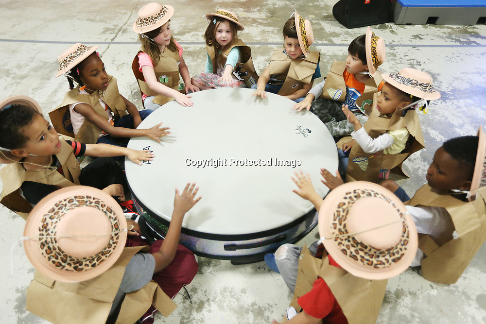 ECEC students in Amanda Young's pre-k class beat on the drum as they rehearse their Jungle Beats performance Monday morning at the school.