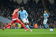 Manchester City midfielder Yaya Toure on the ball during the Champions League Group D match between Manchester City and Sevilla at the Etihad Stadium, Manchester, England on 21 October 2015. Photo by Alan Franklin.