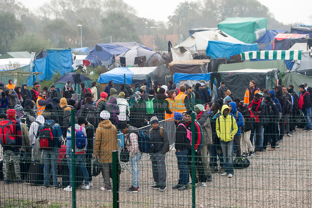 October 24, 2016 - Calais, Northern France, France - Image ¬©Licensed to i-Images Picture Agency. 24/10/2016. Calais, France. Calais Jungle Eviction. Migrants and refugees line up in the container section of the Calais jungle to be processed and then bussed out to reception centres across France. It is estimated that 3000 refugees and migrants to be processed. Picture by Pete Maclaine / i-Images (Credit Image: © Pete Maclaine/i-Images via ZUMA Wire)