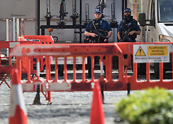 © Licensed to London News Pictures. 19/04/2018.  Armed police watch over a closed off section of Black Rod's Garden after masonry from a sculpture of an angel came loose and fell from Victoria Tower. Black Rod's Entrance and Garden have been closed after the chunk of masonry fell from Victoria Tower at Parliament. London, UK. Photo credit: Peter Macdiarmid/LNP