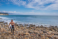 A surfer at Point Dume in Malibu, California.