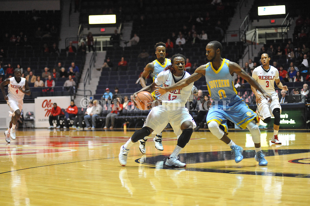 "Ole Miss guard Stefan Moody (42) drives past Southern University Jaguars guard Christopher Hyder (0) to score at the C.M. ""Tad"" Smith Coliseum in Oxford, Miss. on Thursday, November 20, 2014. (AP Photo/Oxford Eagle, Bruce Newman)"
