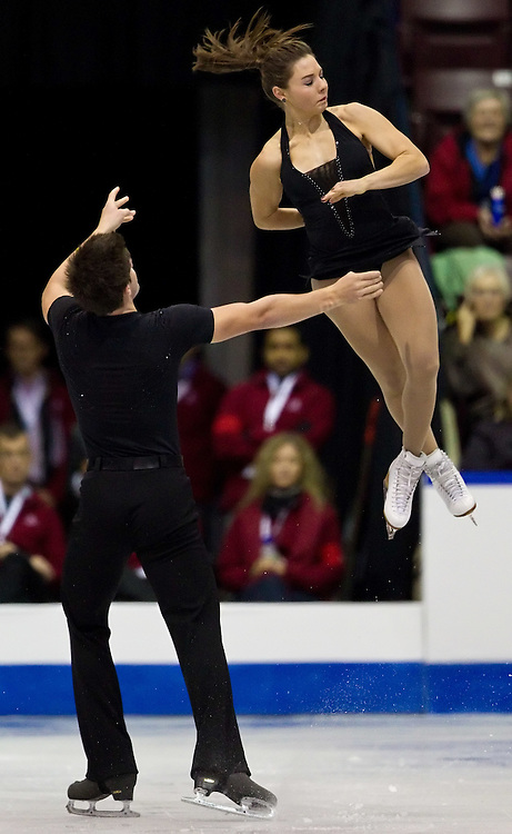 GJR -20111028- Mississauga, Ontario,Canada-  Jessica Dube of Canada  is thrown by her partner Sebastien Wolfe during their short program at Skate Canada International, October 28, 2011.<br /> AFP PHOTO/Geoff Robins