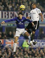 Photo: Dave Howarth.<br /> Everton v Charlton Athletic. The Barclays Premiership.<br /> 02/01/2005.  Charlton's Shaun Bartlett out jumps Everton's Nuno Valente