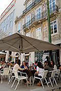 Patrons enjoy the outdoor cafe at Chiado Terrasse in Lisbon.