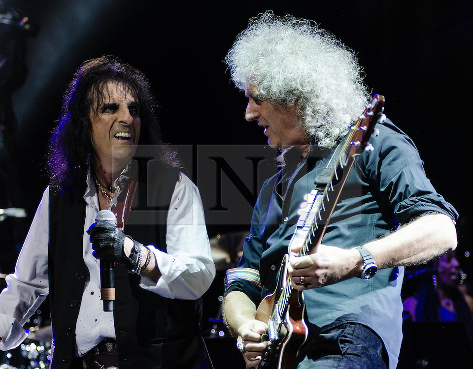 """© Licensed to London News Pictures. 16/09/2012. London, UK.  Alice Cooper (Centre) and Brian May (Right) performs at The Sunflower Jam at the Royal Albert Hall.  The Sunflower Jam is a British charity, founded by Jacky Paice, wife of Deep Purple drummer, Ian Paice. Other high-profile supporters are the actor Jeremy Irons, ex-Jamiroquai bassist Nick Fyffe and Charles, Prince of Wales. The aims of the charity are to fund complementary therapists and spiritual healers to work on cancer wards in the British National Health Service. After setting up a meeting between members of Deep Purple and a young boy dying of leukemia, Paice saw """"all the good work the healers were doing"""" and decided """"lets find a way to raise money to get more healers in there. Photo credit : Richard Isaac/LNP"""