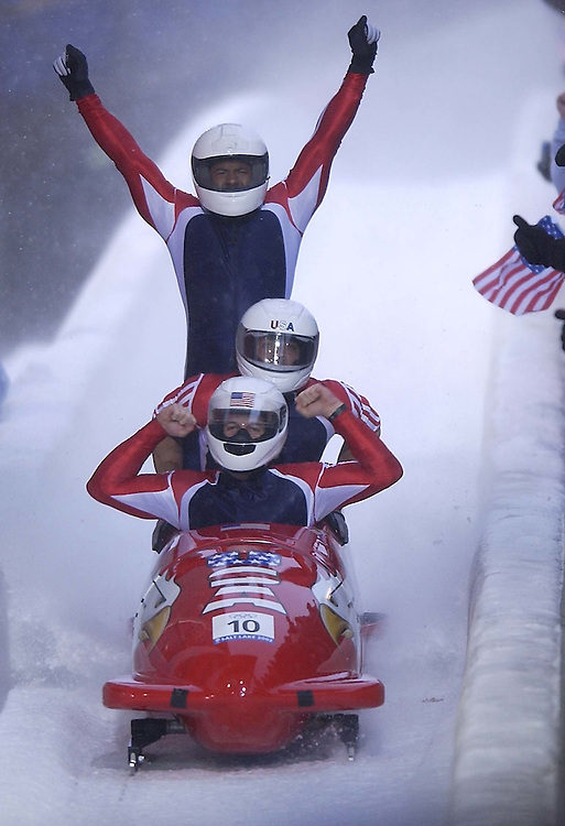 .USA 1 comes into the finish line  for a sliver medal in the 4-man bobsled Saturday Feb. 23, 2002. (from front to back Todd Hays, pilot, Randy Jones, (can't see his face) Bill Schuffenhauer and brakeman Garrett Hines standing.